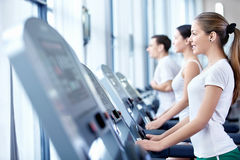 Sports people on treadmills Royalty Free Stock Images