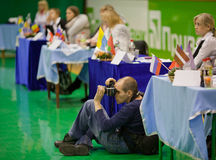 Sports photogapher - gymnastics competition. Sports photogapher at jury. Gimnastics open tournament. 16-17th December 2011, Lviv, Ukraine stock image
