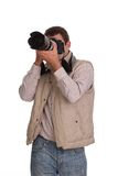 Sports photographer. Young professional sports photographer with his camera Stock Image