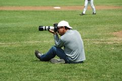 Sports Photographer. Taking pictures of baseball at the Australian Masters in Adelaide, South Australian 2005 Stock Images