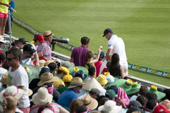 Cricketer with autograph seekers Stock Photography