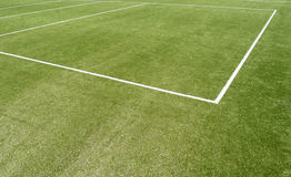 Sports pitch line markings. Close up of white line markings on grass sports pitch Royalty Free Stock Image