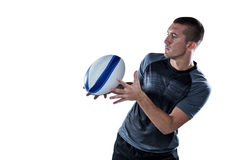 Sports player catching the ball Royalty Free Stock Photos