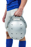 Sports player handing his helmet. On a white background Stock Photography