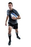 Sports player running with ball Royalty Free Stock Photography