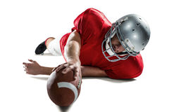Sports player struggling to catch the ball Stock Image