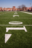 Sports Playing Field Inner City Chicago Neighborhood. The 10 yard line on an inner city gaming field Royalty Free Stock Photos