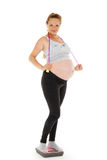 Sports  pregnant woman with scales. Royalty Free Stock Image
