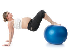 Sports pregnant young woman. Royalty Free Stock Images