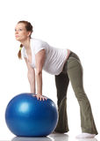 Sports pregnant young woman. Fitness. Royalty Free Stock Photography