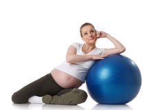 Sports pregnant young woman. Fitness. Royalty Free Stock Photos