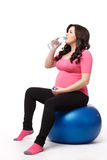 Sports pregnant young woman. Fitness. Stock Photography