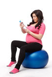 Sports pregnant young woman. Fitness. Stock Images