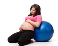 Sports pregnant young woman. Fitness. Royalty Free Stock Photo