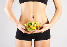 Sports pres young girl. Salad Stock Images