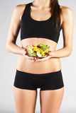 Sports pres young girl. Salad Stock Image