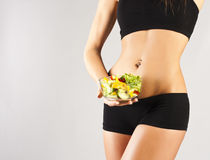 Sports pres young girl. Salad Royalty Free Stock Images