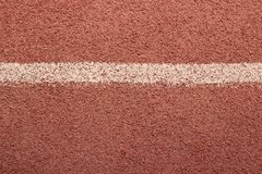Sports red cover with white stripe, texture for your design, background royalty free stock image
