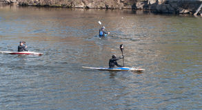 Sports rowing competitions. Kayak paddlers in it on the water of the river and see the Beach Stock Photography