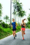 Sports. Runner Couple Running, Jogging On Road. Fitness, Healthy Royalty Free Stock Photos