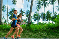 Sports. Runner Couple Running, Jogging On Road. Fitness, Healthy Royalty Free Stock Photography