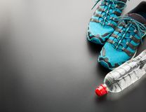 Sports runners and a bottle of water Royalty Free Stock Photos