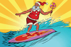 Sports Santa Claus on a surfboard Royalty Free Stock Images