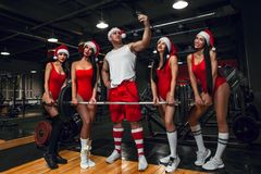 Santa Claus taking selfie by mobile with girls royalty free stock photos