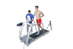 Sports Scientist doing Performance Assessment with Treadmill. And High Speed Camera. Modern Technology Royalty Free Stock Photo