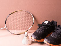 Sports set of black orange sport shoes and shuttlecocks with two Stock Images