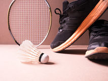Sports set of black orange sport shoes and shuttlecocks with two Royalty Free Stock Photo