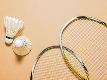Sports set of shuttlecocks with two badminton racket on plywood background Stock Image