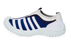 Sports shoe made ​​of cloth with rubber sole Stock Photos