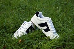 Sports shoes. On the green grass Royalty Free Stock Photos