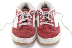 Sports shoes. An old worn pair of children's sports shoes Stock Photos