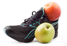 Sports shoes and an apple Stock Photo