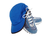 Sports shoes and cap Royalty Free Stock Image