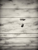 Sports Shoes Hanging from Power Lines Stock Images