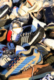 Sports shoes heap Stock Images