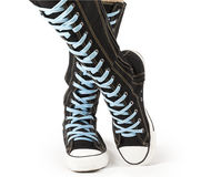 Sports shoes - high top knee sneakers Stock Images