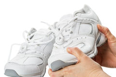Sports shoes in his hands Stock Photos