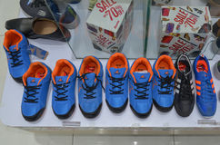 Sports Shoes for sale. Sports Shoes in a shop at Emporium Mall, Lahore, Pakistan Royalty Free Stock Photo