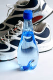 Sports shoes and water bottle Royalty Free Stock Image