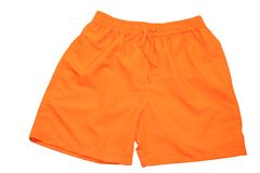 Sports Shorts. A pair of orange colored sports shorts against a white background Royalty Free Stock Images