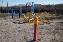 Sports simulators on the playground: horizontal bars and other equipment. stock photos