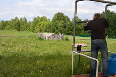 Sports skeet. A man shoots a gun on skeet Stock Image