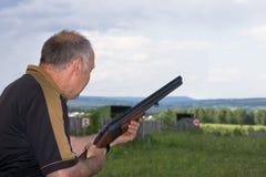 Sports skeet. A man shoots a gun on skeet Royalty Free Stock Images