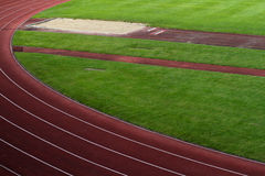 Sports stadium with race tracks and long jump pit Stock Images