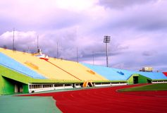Sports Stadium Sideview. Against a rain filled sky Royalty Free Stock Photography