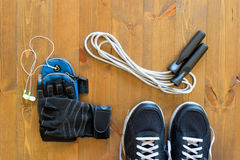 Sports stuff on a dark table. On the floor lay the items for sports Royalty Free Stock Photo